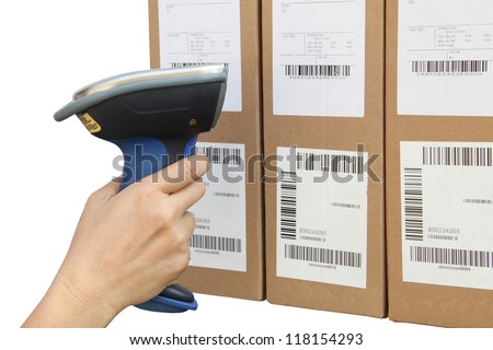 Scanning label on the boxes with bluetooth barcode scanner - stock photo