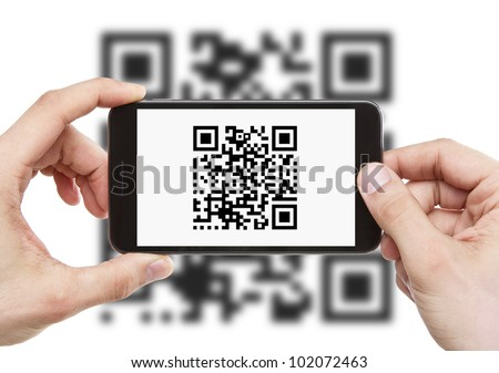 Scanning QR code with mobile smart phone - stock photo