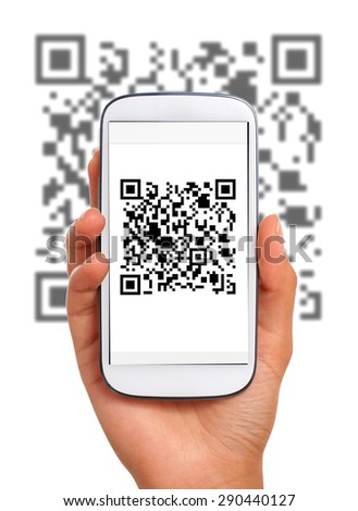 Scanning qr code with smart phone - stock photo