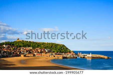 Scarborough beach, castle and harbour - stock photo