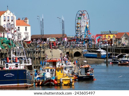SCARBOROUGH, NORTH YORKSHIRE, ENGLAND - 19th May 2014: Scarborough harbor on the 19th of May 2014. This is a popular tourist destination every summer. - stock photo