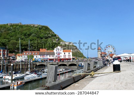 SCARBOROUGH, NORTH YORKSHIRE, ENGLAND - 19th May 2014: Scarborough town and harbor seaside resort on the 19th of May 2014. This is a popular tourist destination every summer. - stock photo