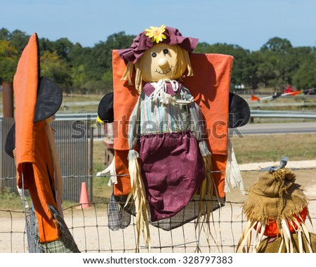 scarecrow on a fence - stock photo