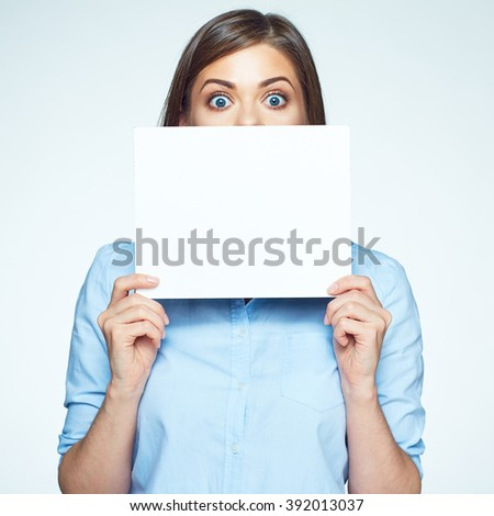 Scared business woman hide face with white sign board. Isolated portrait. - stock photo