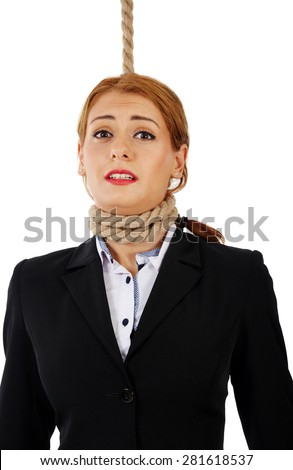 Scared business woman with noose around her neck, about the get hanged - stock photo