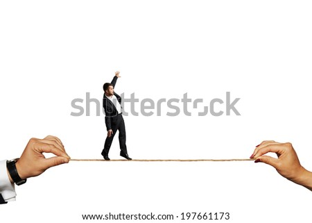 scared businessman balancing on the rope. isolated on white background - stock photo