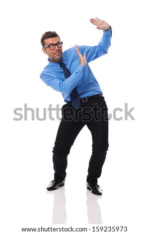 Scared businessman bending under the weight of something - stock photo
