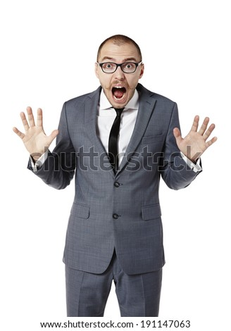 Scared businessman with eyes wide open. Man gesturing with hands. Isolated on white. - stock photo