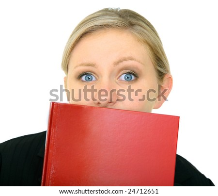 scared female caucasian holding blank book covering her mouth. isolated on white - stock photo