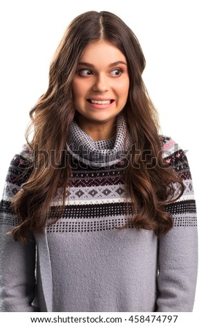 Scared girl in gray sweater. Lady's face shows fear. The most tense moment. Huge problems on horizon. - stock photo