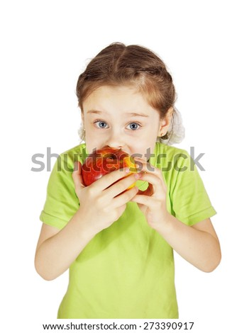 Scared little girl bites a big red apple - stock photo