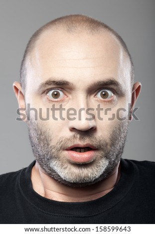 scared man portrait isolated on gray background  - stock photo
