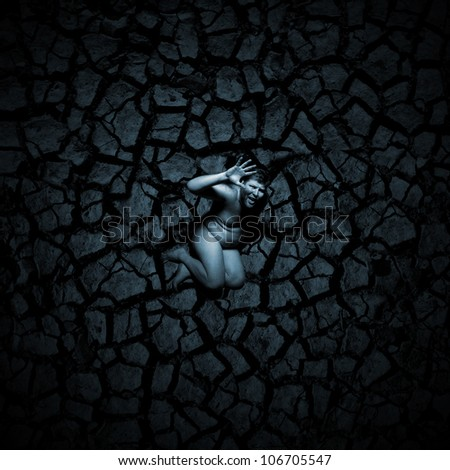 Scared naked man on the cracked soil - stock photo