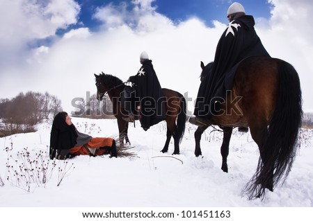 Scared peasant with a firewood bundle and riding knights Hospitallers - stock photo