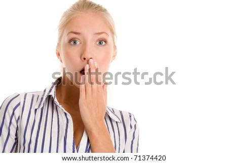 Scared woman covering mouth with hand - stock photo