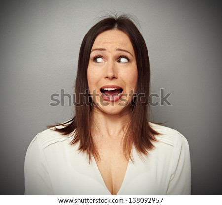 scared woman looking at something at screaming - stock photo