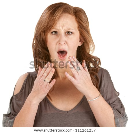 Scared woman with hands near face over white background - stock photo