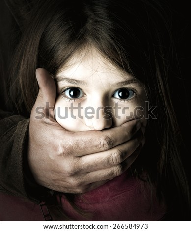 Scared young girl with an adult man's hand covering her mouth - stock photo