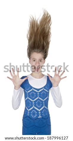 Scared young woman hair stands on ends on isolated white background - stock photo