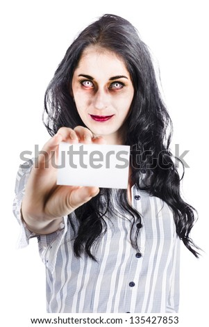 Scary female zombie handing over business card credentials isolated over white background - stock photo