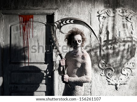 Scary ghost a scythe in the old house - stock photo