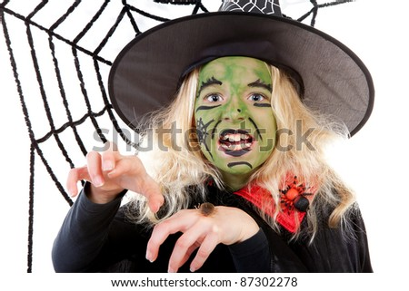Scary green witch for Halloween with spiderweb over white background - stock photo