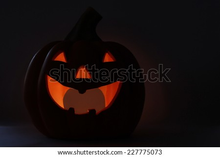 Scary Halloween Jack O Lantern Silhouette with lit cavity - stock photo