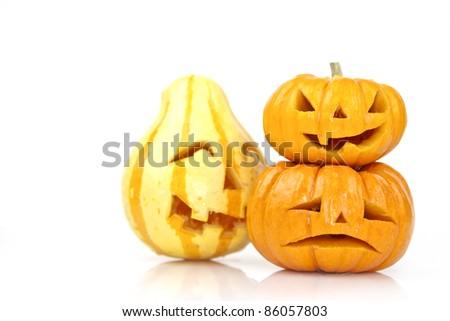 scary halloween orange pumpkins on a white background - stock photo