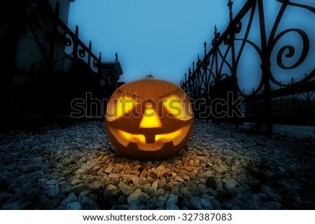 Scary halloween pumpkin in the dark graveyard at night.  - stock photo