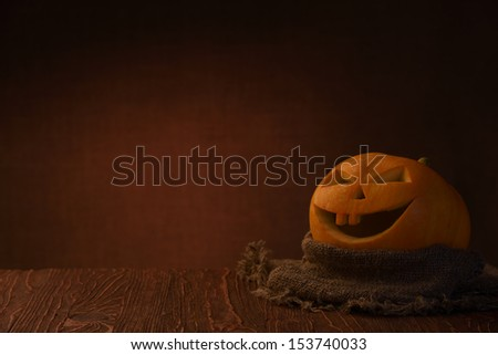 Scary halloween pumpkin on dark background - stock photo