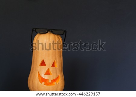 Scary Halloween pumpkin with black sunglasses - stock photo