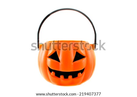 scary halloween's  plastic pumpkin isolated on white background - stock photo
