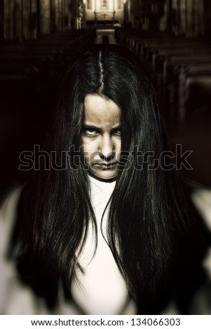 Scary Little Spooky Girl in a Sinister Cathedral - stock photo