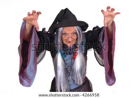 Scary looking Halloween witch, raised arm, clawed hands , holiday, fear concept - stock photo