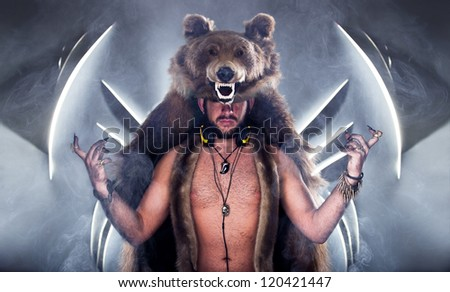 Scary man in a bear coat with scar - stock photo