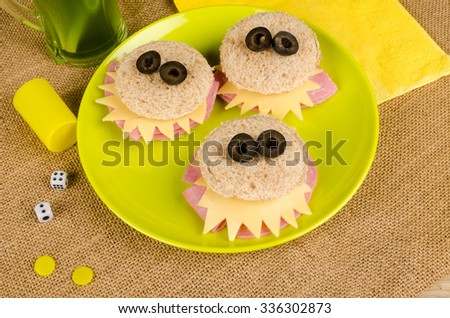 Scary monster sandwiches with olive eyes, creative food for kids - stock photo