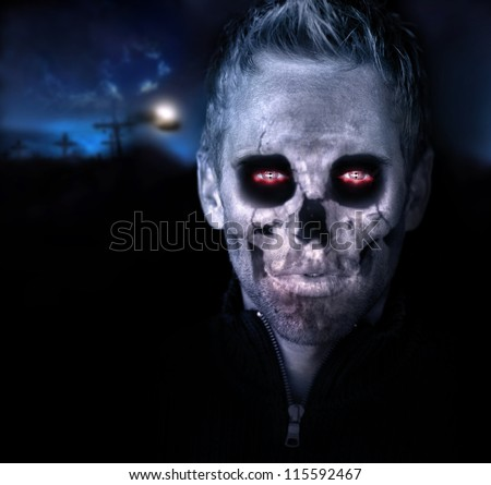 Scary portrait of a zombie in graveyard setting - stock photo