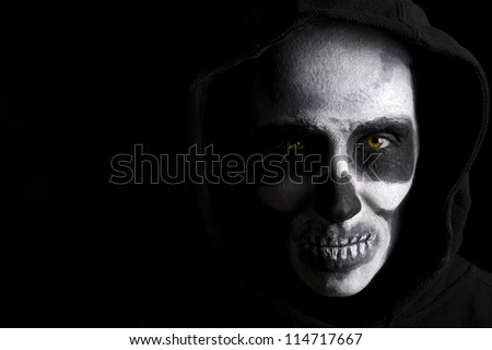 Scary skeleton on black background. - stock photo