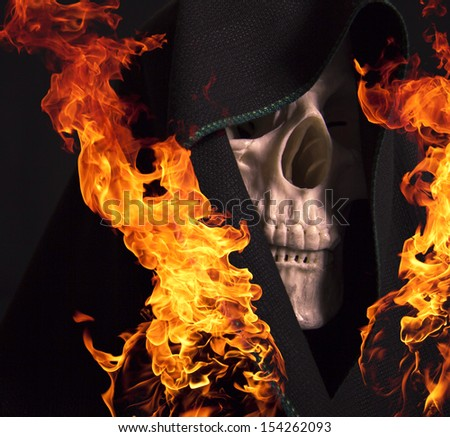 Scary skull and flames of fire. - stock photo