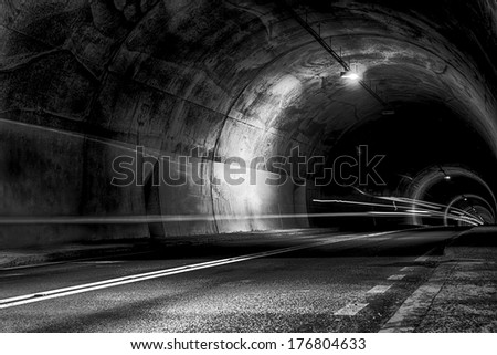 scary tunnel at night with rays of light - stock photo