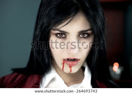 Scary vampire pale looking with red eyes - stock photo