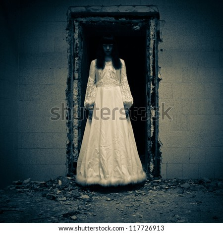 Scary woman in a horror scene - stock photo