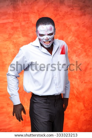 Scary zombies African man on fiery red background. Business man voodoo. Office zombies. Concept of advertising about the heat and after a hard work for office workers. Terrible job. Horror at work. - stock photo