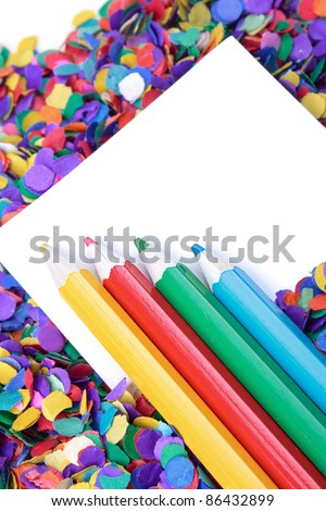 Scattered confetti and colorful pencils, background with copy space. - stock photo