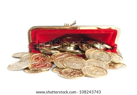Scattered gold coins are in open hot red purse, isolated on white background. A great number of coins symbolize wealth, richness, income and profit. Close up shot. - stock photo
