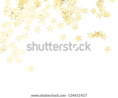 Scattered golden stars decorations isolated on white background - stock photo