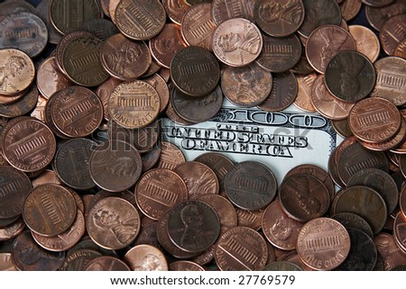 Scattered pennies on top of a hundred dollar bill. - stock photo