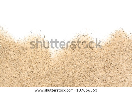 scattered sand on white background - stock photo