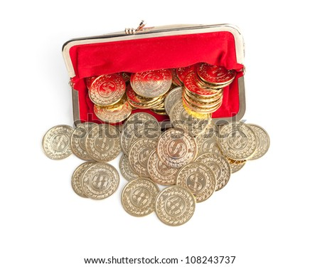 Scattered silver and gold coins are in red purse, isolated on white background. A great number of coins symbolize wealth, richness, income and profit. Close up shot. - stock photo