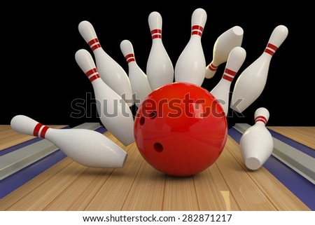 scattered skittle and bowling ball on wooden floor - stock photo